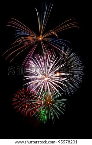 Fireworks display isolated on black - stock photo