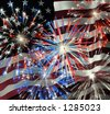 Fireworks displayed over the American Flag - stock photo