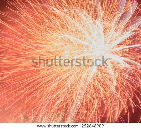 Fireworks exploding in the night sky - stock photo