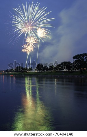 Fireworks exploding over Arkansas River and ball field in Wichita, KS. - stock photo