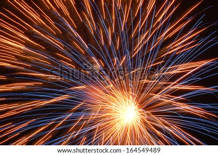 Fireworks explosion on black sky background - stock photo