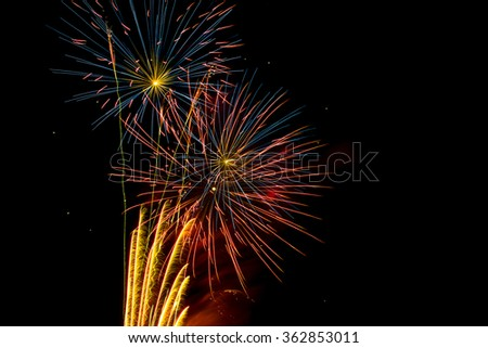 Fireworks explosion with red, orange,blue and gold colors. - stock photo