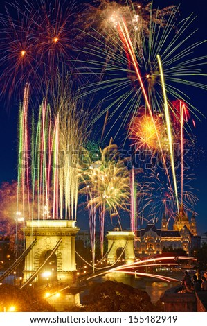 fireworks fill the dark blue sky over city of Budapest - stock photo