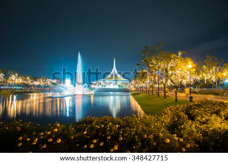 Fireworks for the Thailand King birthday show in the park with nice fountain and flower. - stock photo