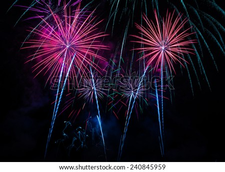 Fireworks Four - four red Firework Blast at 1st of january 2015 celebration in Chiang Mai Thailand. - stock photo