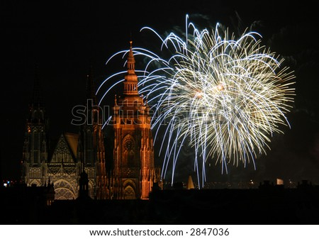 Fireworks illuminate the sky over St Vitus Cathedral at the Prague Castle, Czech Republic, to celebrate the New Year - stock photo