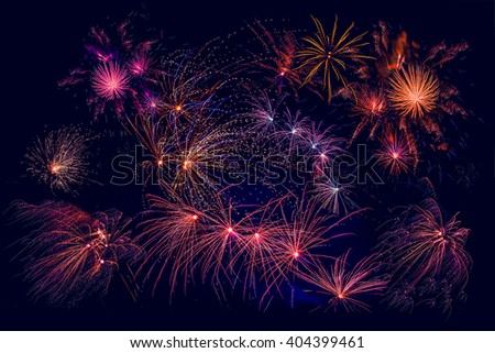 Fireworks in beautiful colors at new years eve - stock photo