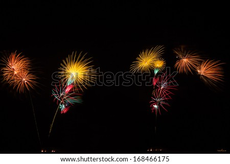 Fireworks in black sky, new year or independence day celebration