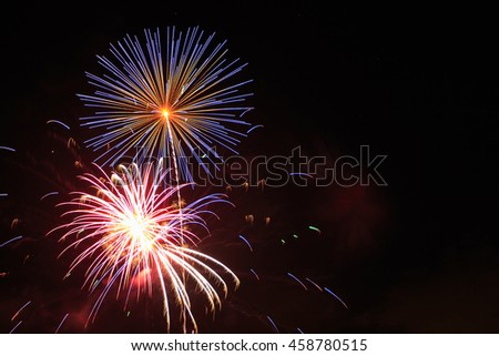 Fireworks in night sky with copy space. - stock photo