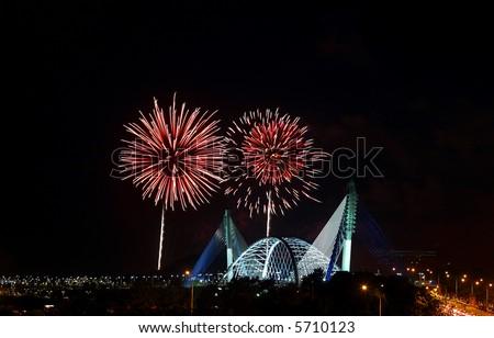 Fireworks in Putrajaya over landmark Seri Saujana Bridge. - stock photo