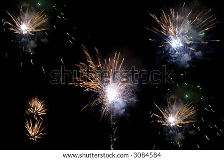 fireworks in the black sky at night - stock photo