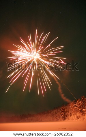 Fireworks in the New Years Eve. Northern lights on the background gives the sky a green glow. - stock photo