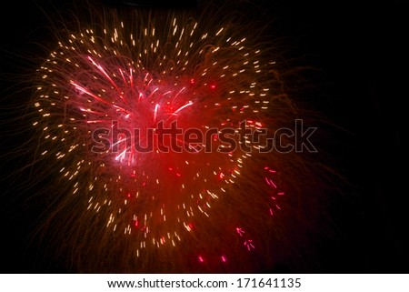 Fireworks in the night sky in the form of heart . - stock photo