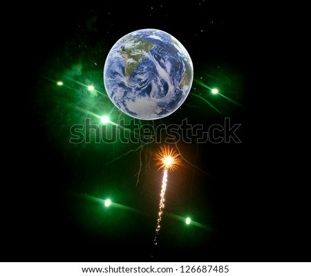 Fireworks in the night sky with the Earth. - stock photo