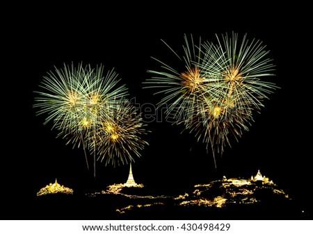 Fireworks light up the sky for anniversary celebration. - stock photo