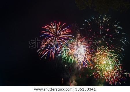 Fireworks light up the sky with dazzling display. Slightly soft focus due to Slow Shutterspeed - stock photo
