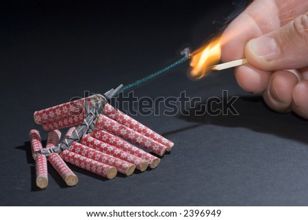 Fireworks lit with flame of match 02 - stock photo
