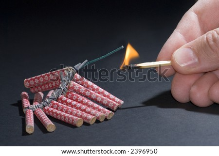 Fireworks lit with flame of match 01 - stock photo