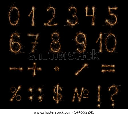 Fireworks numbers and symbol on black background - stock photo