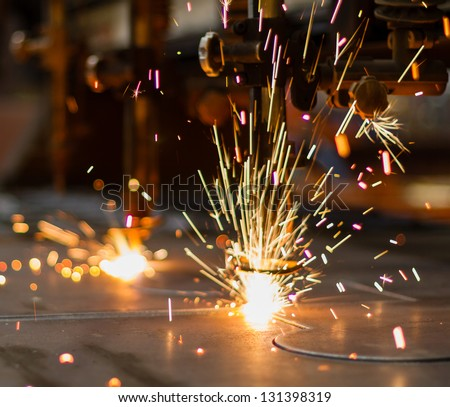 Fireworks of CNC LPG gas cutting close-up - stock photo