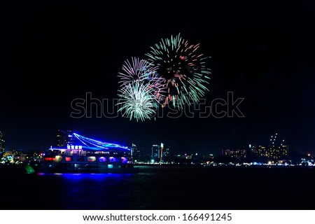 Fireworks on the sea and have boat front view - stock photo