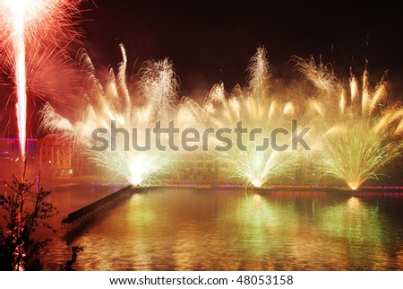 Fireworks on the water - stock photo