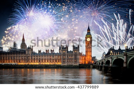 Fireworks over Big Ben Clock Tower and Parliament house at city of westminster, London England UK - stock photo