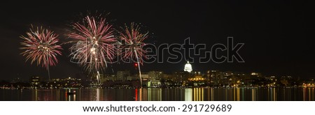 Fireworks over Madison, Wisconsin and state capital across Lake Monona during the 2015 Shake the Lake festival - stock photo