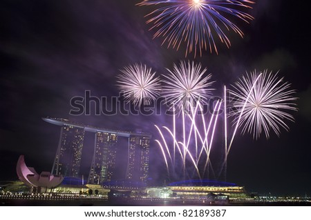 Fireworks over Marina Bay Hotel and Resort during during Singapore National Day Parade 2011 - stock photo
