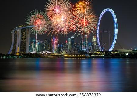 Fireworks over Marina bay in Singapore on New years fireworks celebration - stock photo