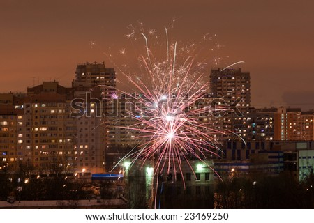fireworks over night city buildings - stock photo