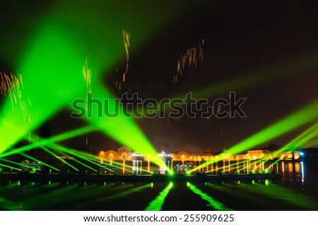 Fireworks over on the Arsenal lagoon during the Carnival celebration in Venice (Italy). Blurred photo. - stock photo