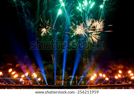 Fireworks over on the Arsenal lagoon during the Carnival celebration in Venice (Italy). Reflection in water. Blurred lights. - stock photo