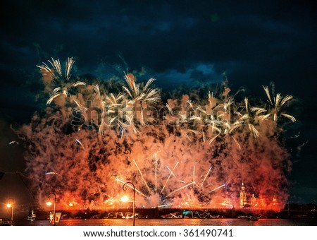 "Fireworks over the city of St. Petersburg (Russia)aqnd Neva River on the feast of ""Scarlet Sails"" - stock photo"