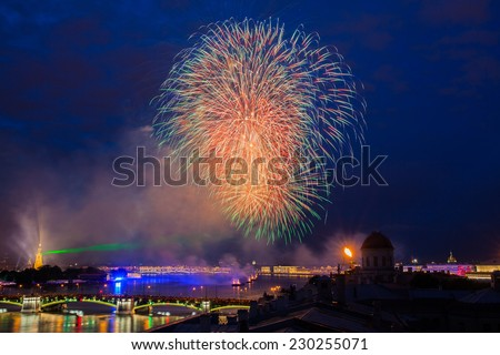 "Fireworks over the city of St. Petersburg (Russia) on the feast of ""Scarlet Sails"", view from roof. View of the Exchange Bridge, Trinity Bridge, rastralnye column and Peter and Paul Fortress."