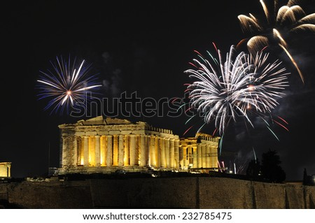 Fireworks over the Parthenon temple on the Acropolis of Athens for New Year celebration   - stock photo
