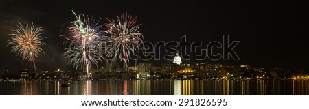 Fireworks over Wisconsin State capital and isthmus across Lake Monona during the 2015 Shake the Lake Festival in Madison Wisconsin  - stock photo