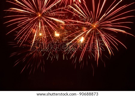 Fireworks, salute on the black sky background - stock photo