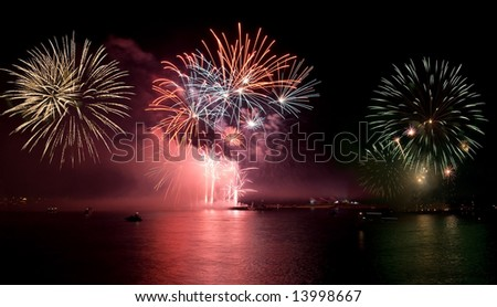 Fireworks with reflections - stock photo