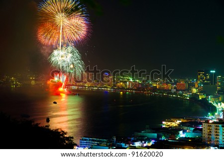 Fireworks with reflections at Pattaya Gulf, Chonburi Province, Thailand