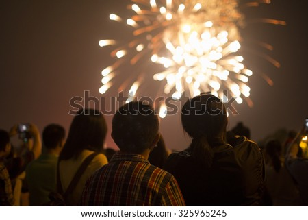 Fireworks with silhouettes of people in a holiday events,Shanghai - stock photo