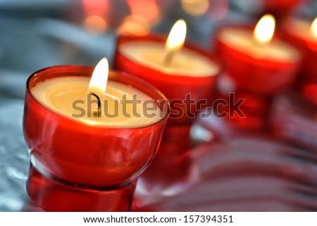 Firing candle closeup image - stock photo