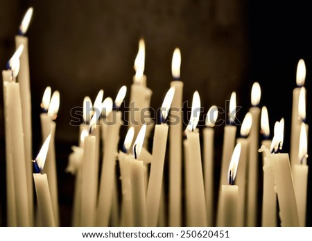 firing candles in catholic church - stock photo