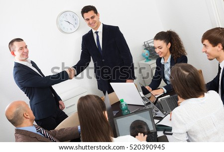 Firm handshake between two business partners on a office meeting
