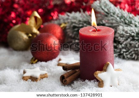 first advent with candle and cookies - stock photo