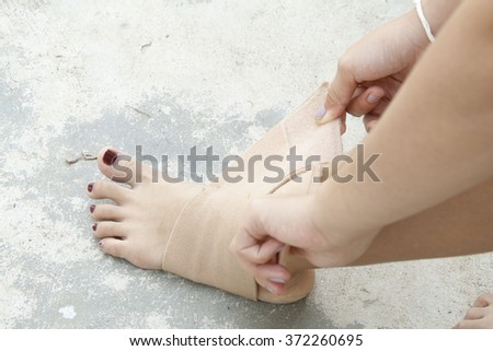 first aid accident ankle by oneself - stock photo