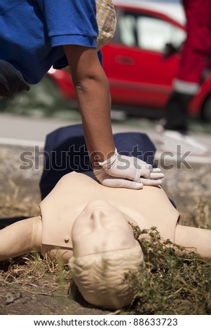 First aid after car crash - stock photo