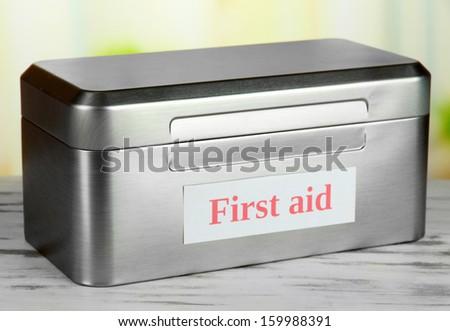 First aid box on bright background