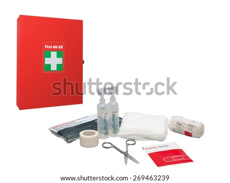 First aid box white cross symbol and medical supplies isolated on a white background. - stock photo