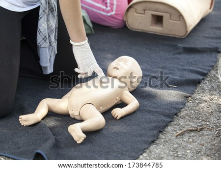 First aid - cardiac massage - stock photo
